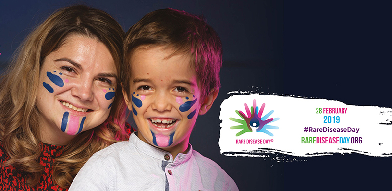 Photo of a child and mom with face paint