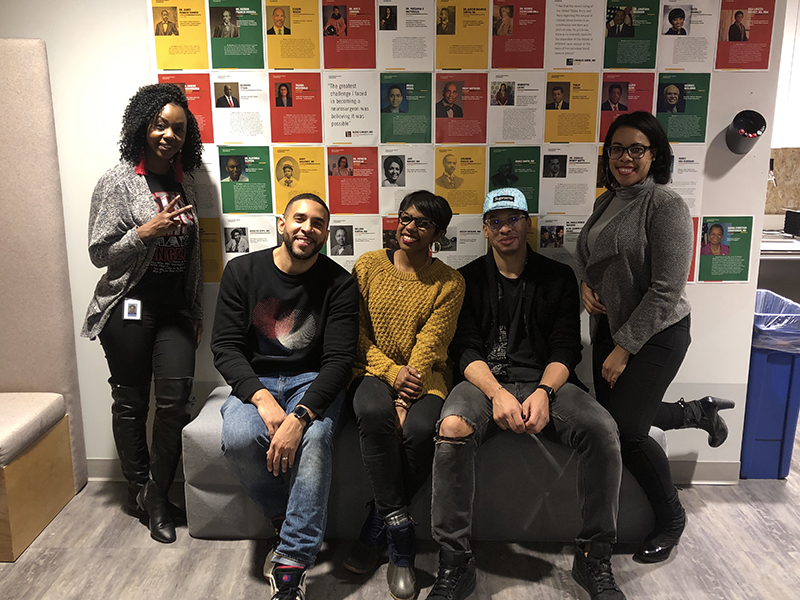 Photo showing a group of five black Intouch employees