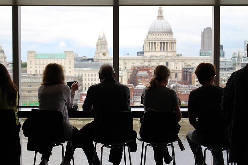 Photo of people sitting in front of a window