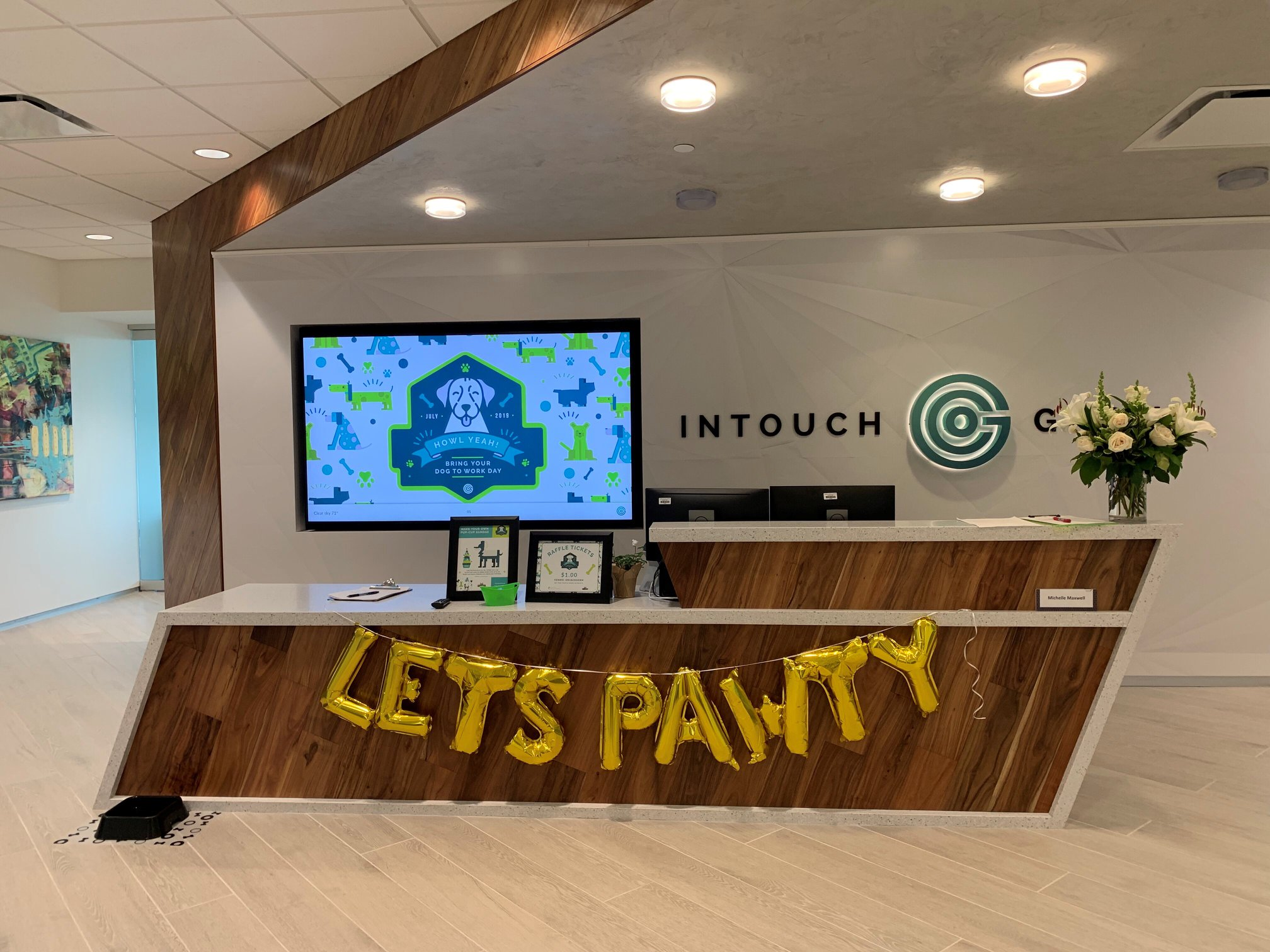 Intouch Group lobby decorated for Bring Your Dog to Work Day