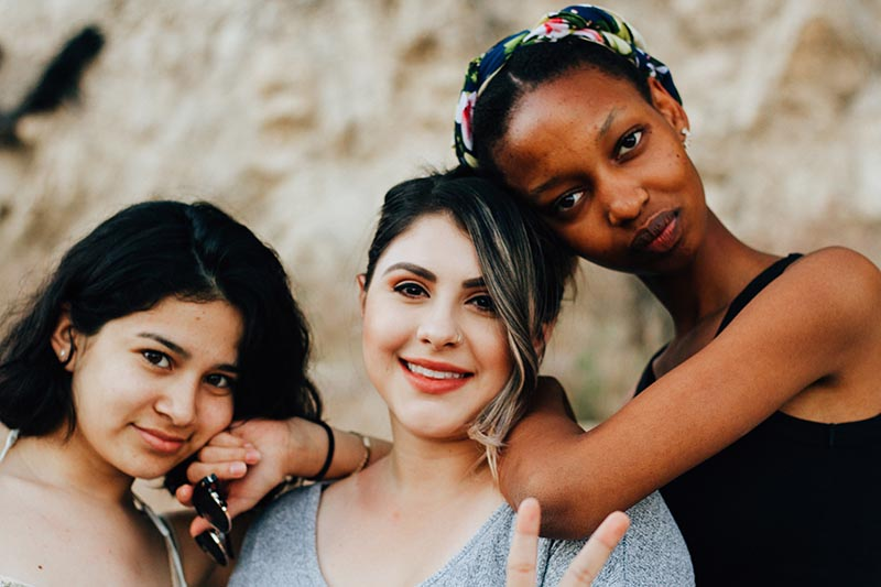 Three young women of diverse backgrounds