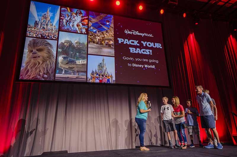 Family on stage wins Disney World trip