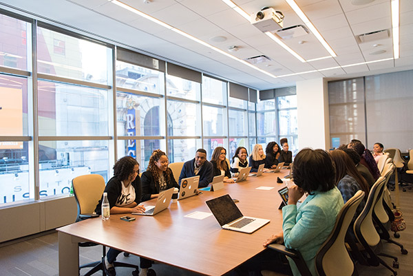 Photo of people meeting at a conference table