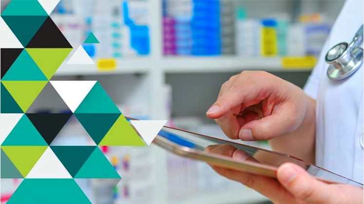 Image of pharmacist selecting on tablet