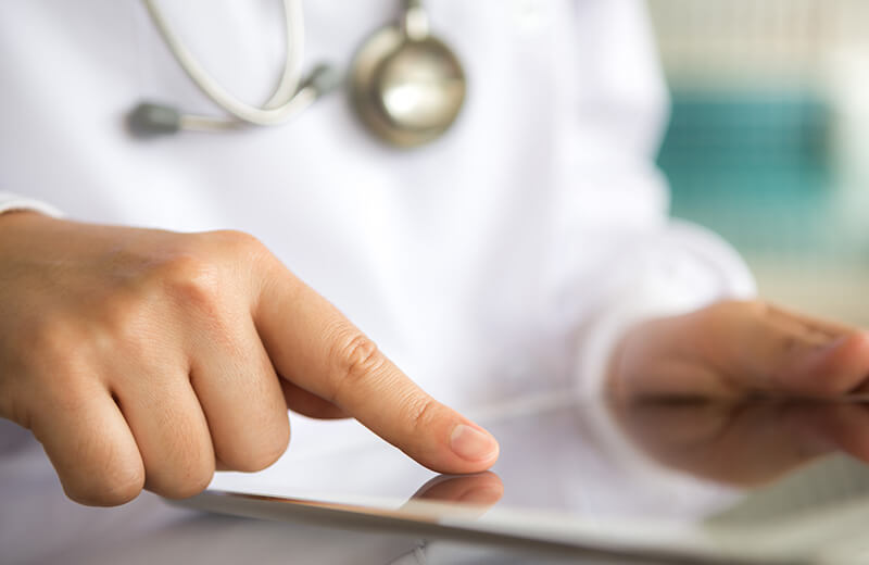 Image of doctor pointing to iPad