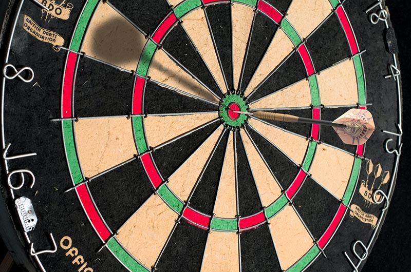 Close-up photo of dartboard with dart in bullseye