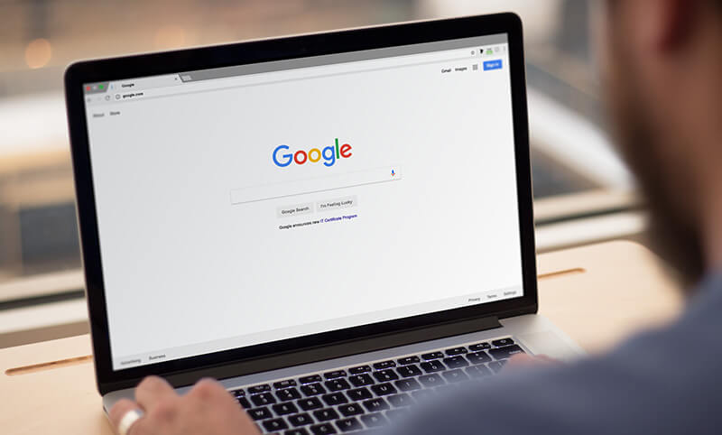 Image of laptop showing google search