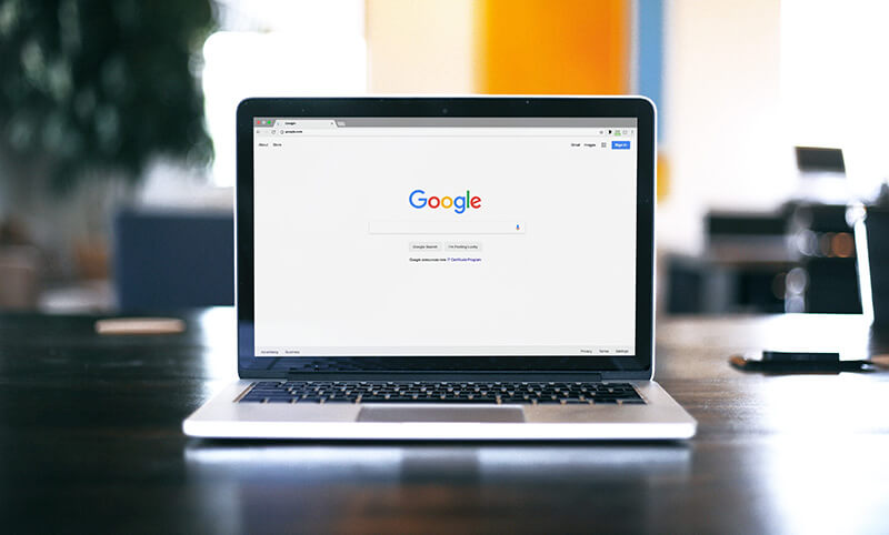 Image of a laptop searching for google