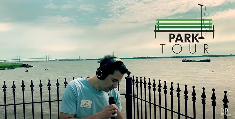 Matt Pierce raps into microphone near river