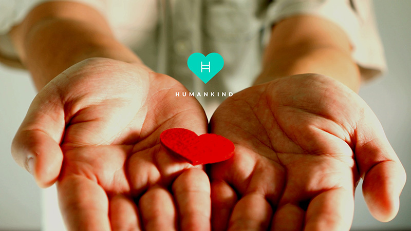 Hands hold heart and logo