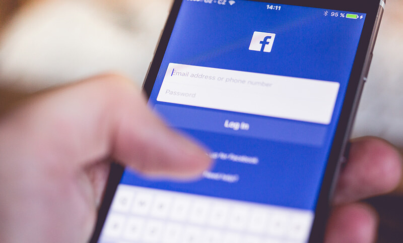 Image of person logging into Facebook