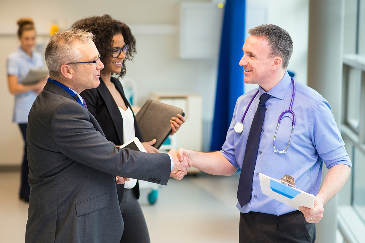 doctors meeting and shaking hands
