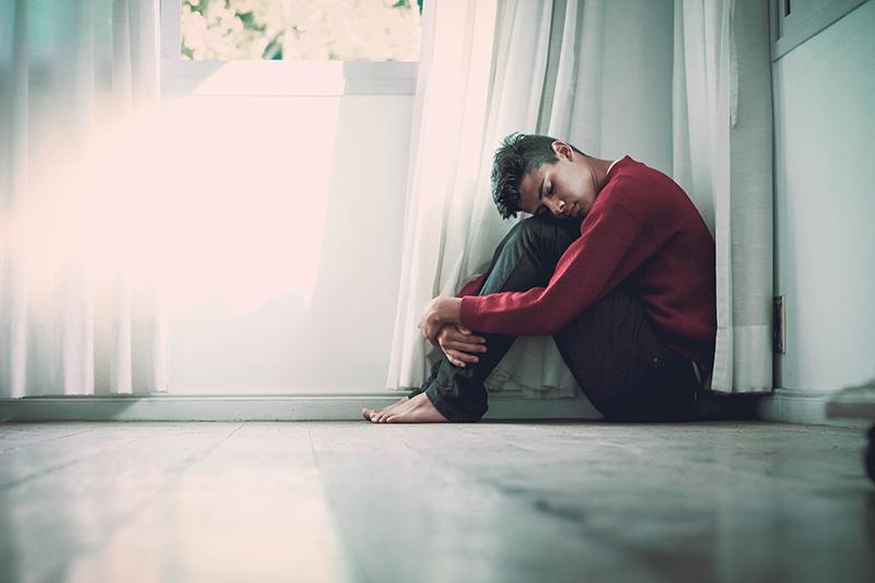 Depressed man sitting